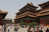 Visitors mingling outside the temples at the Lama Temple in Beijing China The Lama Temple Beijing or Palace of Peace and Harmony Lama Temple or...