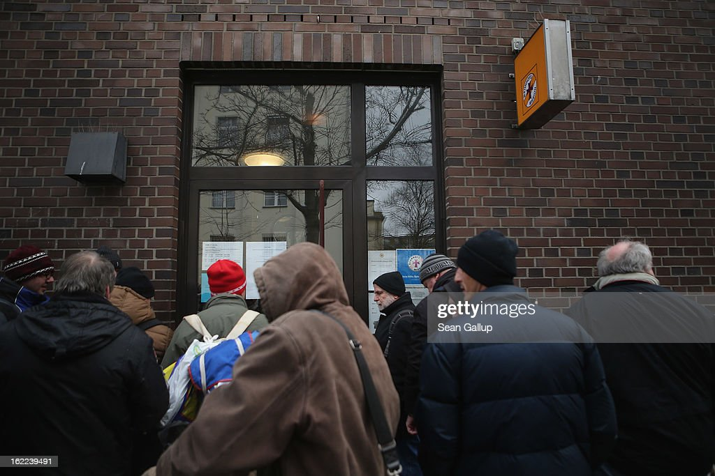 Visitors, mostly homeless men, wait outside the Bahnhofsmission Protestant charity facility for a free lunch at Zoo train station on February 20, 2013 in Berlin, Germany. The Bahnhofsmission feeds up to 600 needy men and women every day, up from 400 only three years ago. Approximately 60% of the visitors are from Eastern Europe, many of them workers in low-paying jobs who became unemployed and ran out of money. Dieter Puhl, who runs the Bahnhofsmission, says he is seeing a steady increase in the number of visitors, especially among older Germans whose pensions are insufficient for them to make ends meet. Poverty in Germany, defined as someone who makes less than 60% of the median wage, has risen steadily in recent years, and according to statistics 14% of people in Germany lived below the poverty line in 2010. Both poverty and pensions that have not kept up with the rising cost of living will be contested topics in federal elections scheduled later for this year.