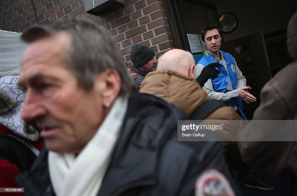 Visitors, mostly homeless men, wait outside the Bahnhofsmission Protestant charity facility for a free lunch as theology student and volunteer Markus prepeares to let them in at Zoo train station on February 20, 2013 in Berlin, Germany. The Bahnhofsmission feeds up to 600 needy men and women every day, up from 400 only three years ago. Approximately 60% of the visitors are from Eastern Europe, many of them workers in low-paying jobs who became unemployed and ran out of money. Dieter Puhl, who runs the Bahnhofsmission, says he is seeing a steady increase in the number of visitors, especially among older Germans whose pensions are insufficient for them to make ends meet. Poverty in Germany, defined as someone who makes less than 60% of the median wage, has risen steadily in recent years, and according to statistics 14% of people in Germany lived below the poverty line in 2010. Both poverty and pensions that have not kept up with the rising cost of living will be contested topics in federal elections scheduled later for this year.