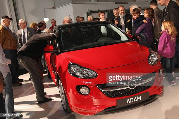 Visitors mostly Opel employees former employees and their family members look at the new Opel Adam car at a celebration at the Opel Insignia and...