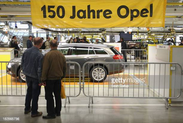 Visitors mostly Opel employees former employees and their family members walk through the Opel Insignia and Astra factory during a celebration...