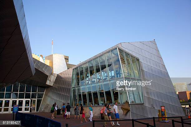 Visitors near odd-shaped Boston aquarium
