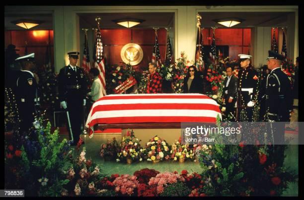 Visitors observe the flagdraped coffin of Richard Nixon at his memorial held at the Nixon Library April 27 1994 in Yorba Linda CA Nixon died April 22...