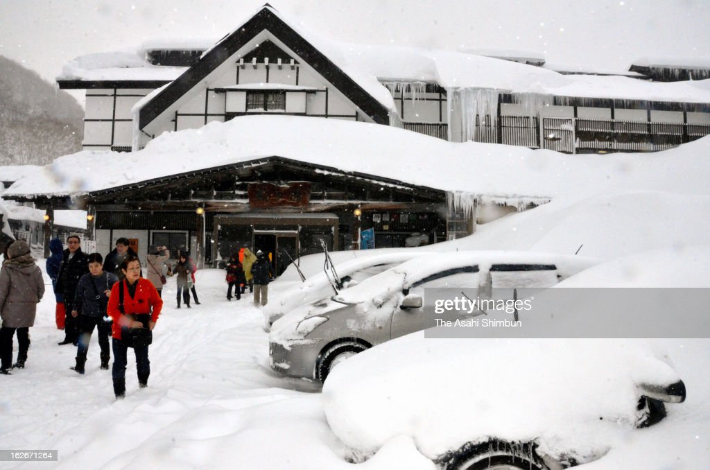 Visitors of a Sukayu hot spring inn take photographs on February 25, 2013 in Aomori, Japan. 561 centimeters snowfall is observed at the resort, extending their own snowfall record.