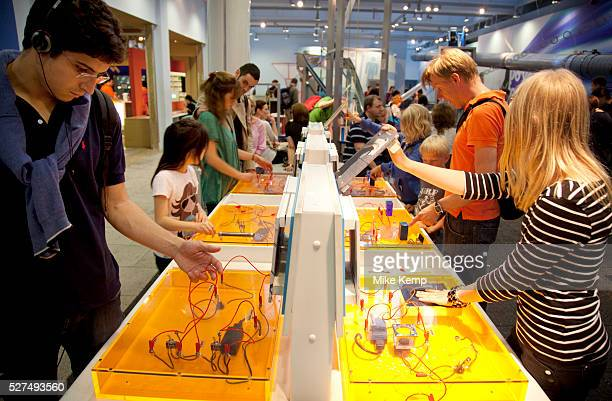 Visitors of all ages play with interactive games objects and exhibits Each one making a scientific point The Science Museum London The Science Museum...