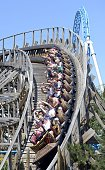 Visitors of German theme park Europa Park take a ride on the roller coaster 'Wodan' at the park in Rust southwestern Germany on July 6 2015 The...