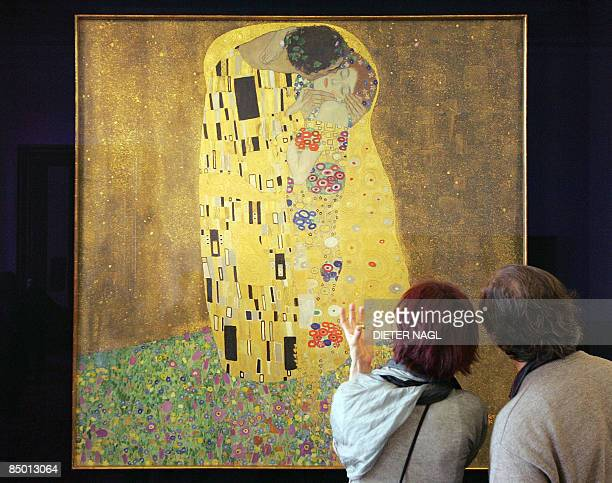 Visitors of the Belvedere Museum look at Gustav Klimt´s painting 'Der Kuss' on February 24 2009 in Vienna Gustav Klimt finished this painting one...