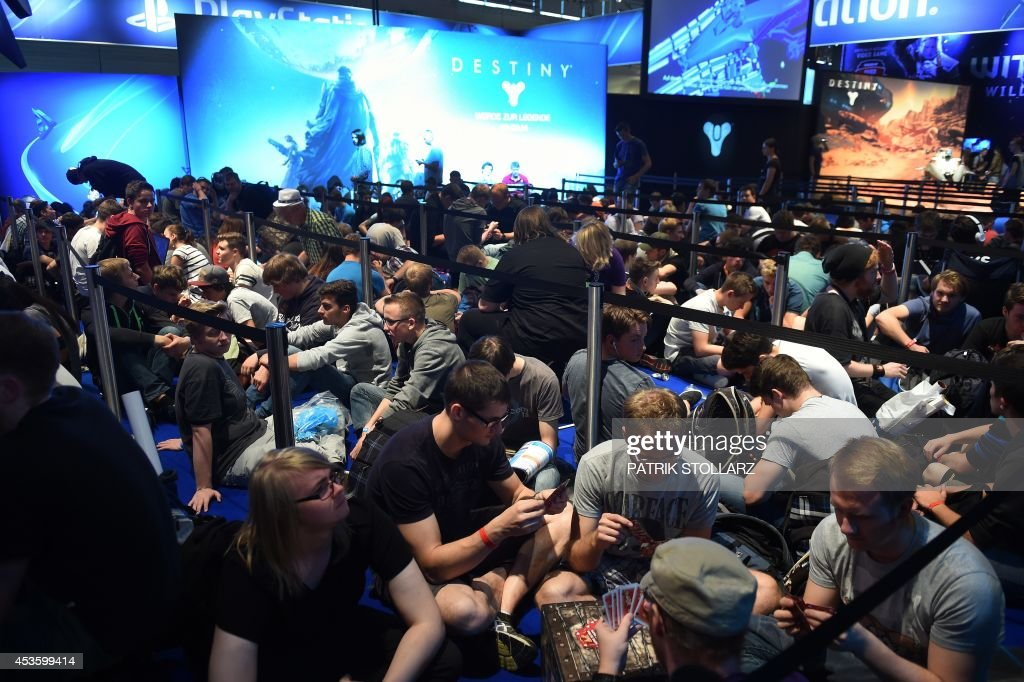 http://media.gettyimages.com/photos/visitors-of-the-gamescom-fair-queue-to-try-out-the-destiny-game-on-picture-id453599414