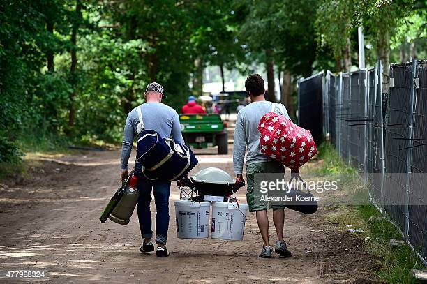 Visitors of the Hurricane Festival 2015 are seen the leaving campsite on June 21 2015 in Scheessel Germany More than 70 bands are expected to perform...