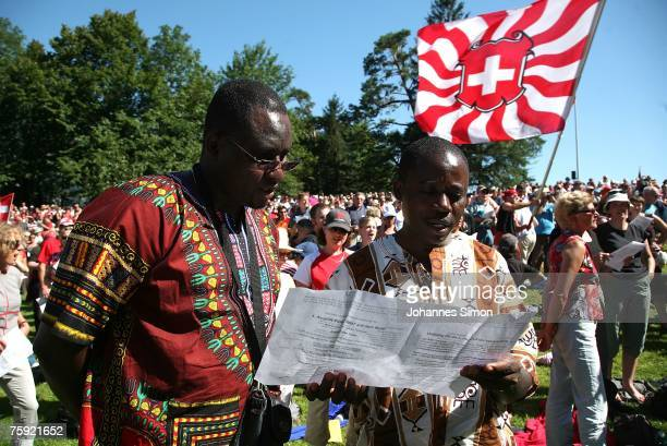 Visitors of the Ruetli celebrations sing the Swiss national anthem on August 1 2007 near Luzern Switzerland Every year the reenactment of the forming...