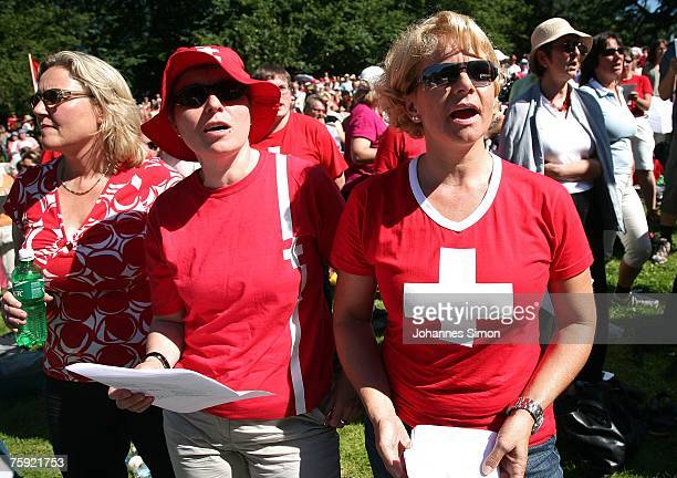 Visitors of the Ruetli celebrations sing the Swiss national anthem on August 1 near Luzern Switzerland Every year the reenactment of the forming of...