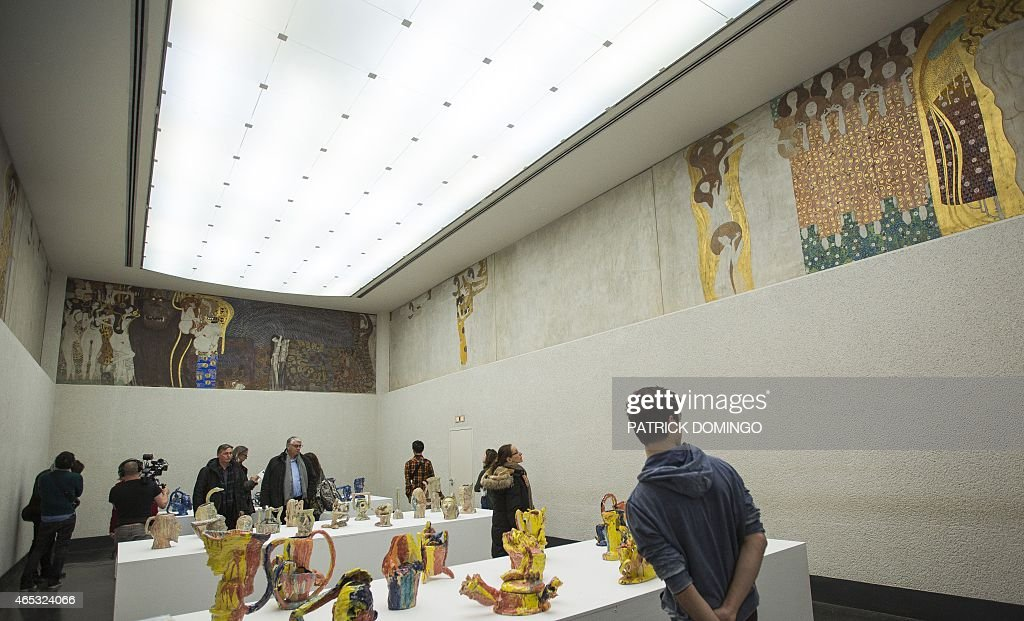Visitors of the Secession Museum stand in a hall where the so ...