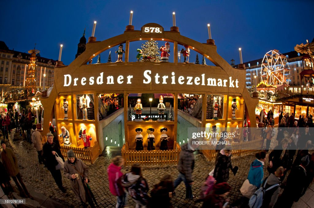 Visitors of the so-called Striezelmarkt crowd the Christmas market just after its opening on November 28, 2012 in Dresden, eastern Germany. Visitors of the Christmas market can buy the traditional Striezel or Stollen fruit loaf, hot punch, gingerbread and craftwork at around 240 market stands up to Christmas Eve. Striezel (or Stollen), a fruit loaf made of yeast dough, almonds, raisins and other ingredients, is a culinary specialty of the eastern German town. MICHAEL