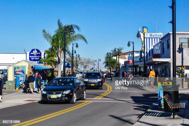 Visitors on street of Tarpon Springs Art galleries antiques stores and specialty shops Florida United States