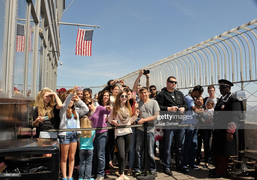 Visitors on the 86th floor Observatory at The Empire State Building look on during a photo op with actors <a gi-track='captionPersonalityLinkClicked' href=/galleries/search?phrase=Kendall+Schmidt&family=editorial&specificpeople=6326531 ng-click='$event.stopPropagation()'>Kendall Schmidt</a> and <a gi-track='captionPersonalityLinkClicked' href=/galleries/search?phrase=James+Maslow&family=editorial&specificpeople=6522849 ng-click='$event.stopPropagation()'>James Maslow</a> on April 17, 2013 in New York City.