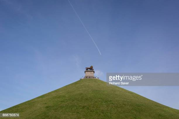 Visitors on the top of the 43 metre high Waterloo Lion's battlefield Mound on 25th March 2017 at Waterloo Belgium The Lion's Mound Butte du Lion is a...