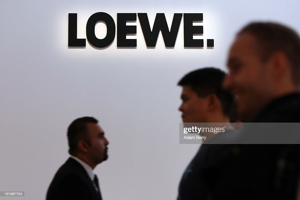 Visitors pass a Loewe logo during the Internationale Funkausstellung (IFA) 2012 consumer electronics trade fair on August 31, 2012 in Berlin, Germany. Microsoft, Samsung, Sony, Panasonic and Philips are amongst many of the brands showcasing their latest consumer electronics hardware, software and gadgets to members of the public from August 31 to September 5.