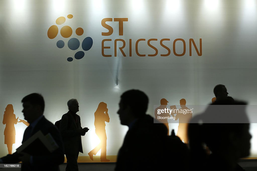 Visitors pass a sign outside the ST-Ericsson AB pavilion at the Mobile World Congress in Barcelona, Spain, on Tuesday, Feb. 26, 2013. The Mobile World Congress, where 1,500 exhibitors converge to discuss the future of wireless communication, is a global showcase for the mobile technology industry and runs from Feb. 25 through Feb. 28. Photographer: Simon Dawson/Bloomberg via Getty Images