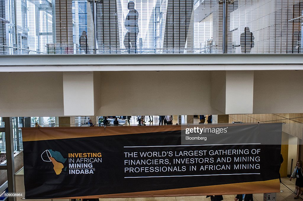 Visitors pass above a banner on the opening day of the Investing in African Mining Indaba in Cape Town, South Africa, on Monday, Feb. 8, 2016. With many miners battling to stay afloat, fewer are willing to shell out 1,140 pounds ($1,641) for the Investing in African Mining Indaba conference in South Africa and business-class airfare. Photographer: Waldo Swiegers/Bloomberg via Getty Images