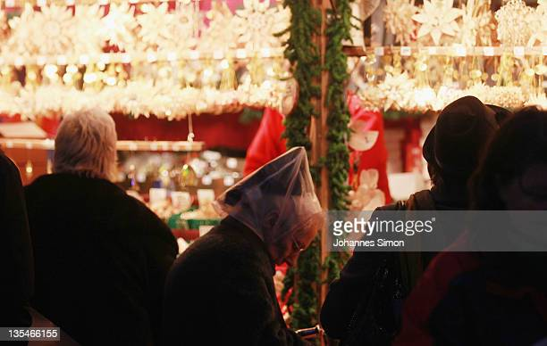 Visitors pass at Munich Marienplatz Christmas market on December 9 2011 in Munich Germany The Marienplatz Christmas market claims to be one of...