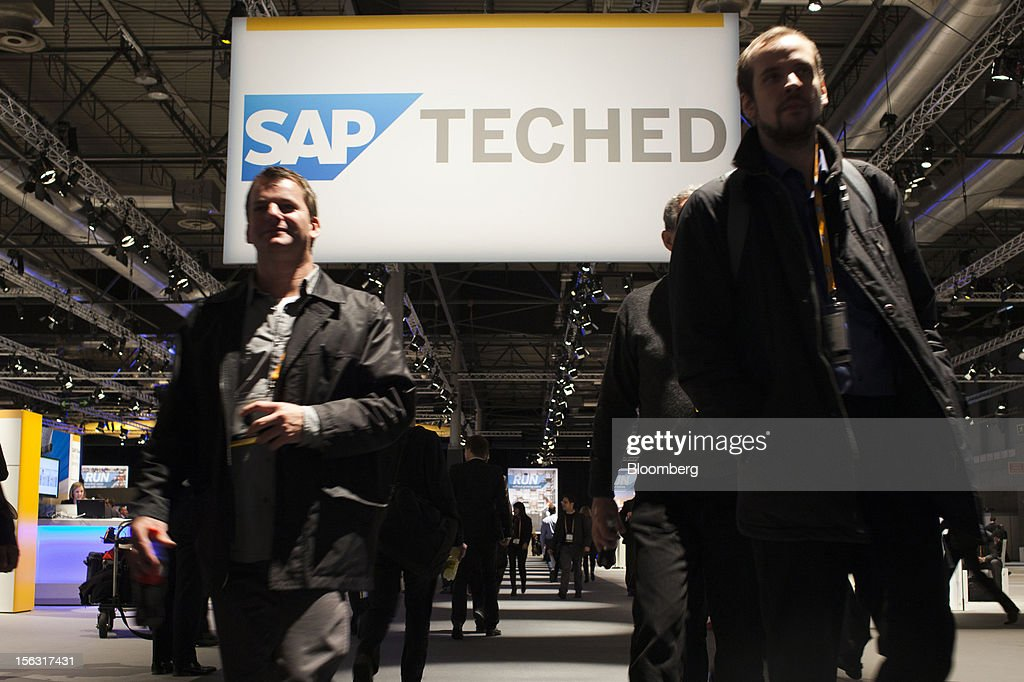 Visitors pass beneath a SAP TechEd banner in a hall on the opening day of the Sapphire Now and TechEd conference in Madrid, Spain, on Tuesday, Nov. 13, 2012. SAP plans to deliver 6 SAP mobile apps for Windows 8. Photographer: Angel Navarrete/Bloomberg via Getty Images
