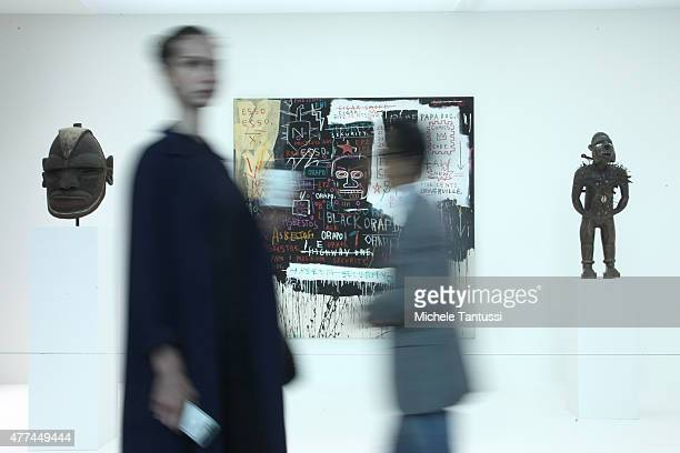 Visitors pass by a Painting of the artist JeanMichel Basquiat Museum Security during the VIP opening day at Art Basel on June 17 2015 in Basel...