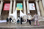 Visitors pass by a sculpture by Singaporean artist Chen Sai Hua Kuan entitled 'Ling Ting 2' during the 2015 Art Paris Art Fair at the Grand Palais on...