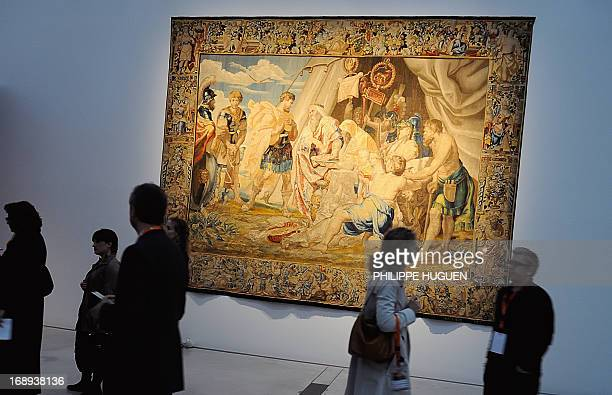 Visitors pass by a wool and silk Jan II Raes tapestry representing the oil painting 'Decius Mus consulte l'oracle ' by Flemish painter Pierre Paul...