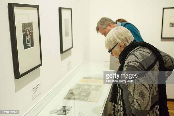 Visitors pass by the artwork 'Mademoiselle Antia' during the 'Robert Doisneau Fotografien' press conference and exhibition preview at Martin Gropius...
