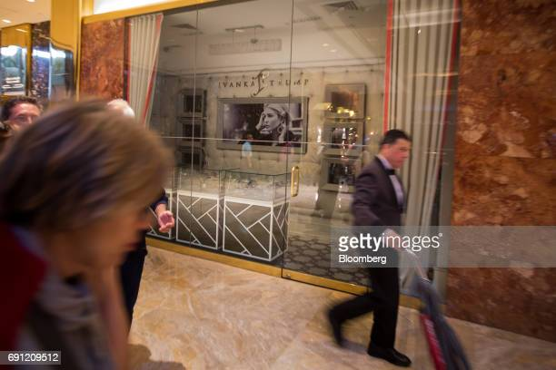 Visitors pass in front of the Ivanka Trump Collection store at Trump Tower in New York US on Thursday June 1 2017 Two Chinese labor activists were...