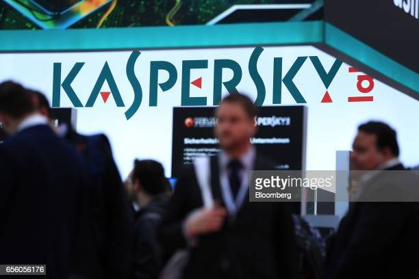 Visitors pass the Kaspersky Lab pavilion at the CeBIT 2017 tech fair in Hannover Germany on Tuesday March 21 2017 Leading edge technologies in the...