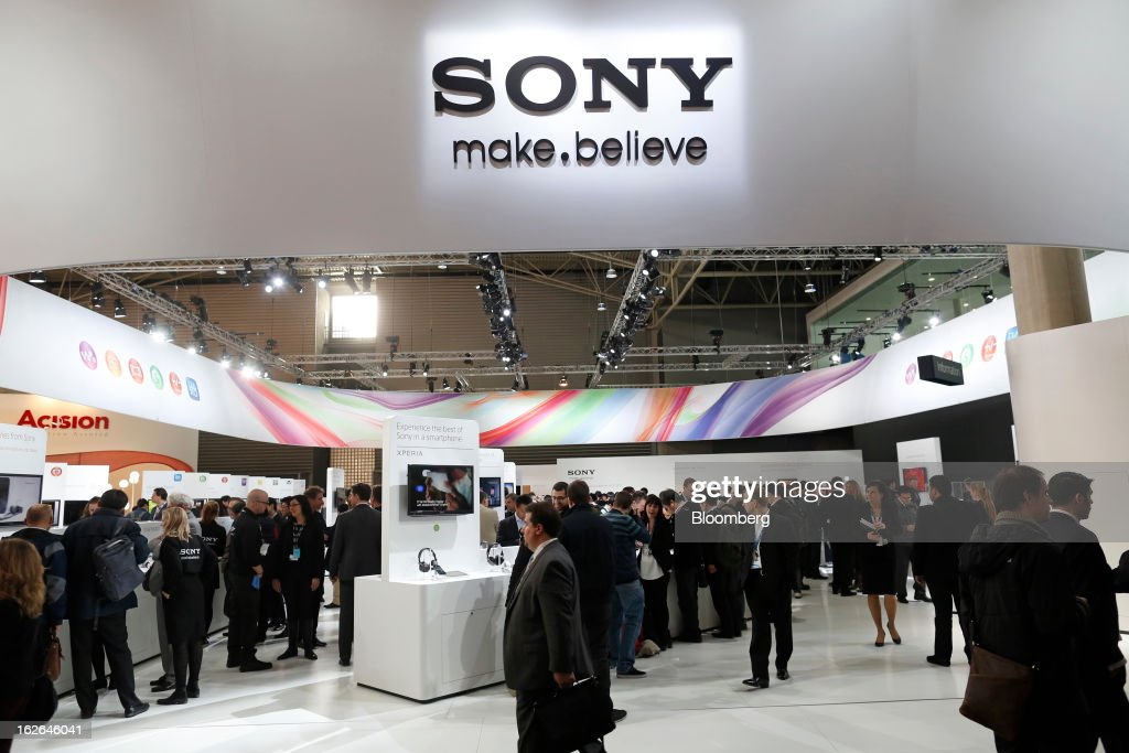 Visitors pass the Sony Corp. pavilion at the Mobile World Congress in Barcelona, Spain, on Monday, Feb. 25, 2013. The Mobile World Congress, where 1,500 exhibitors converge to discuss the future of wireless communication, is a global showcase for the mobile technology industry and runs from Feb. 25 through Feb. 28. Photographer: Simon Dawson/Bloomberg via Getty Images