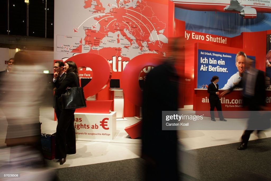 Visitors pass the stand of Air Berlin on the opening day of the 'Internationale Tourismus Boerse' fair on March 08 2006 in Berlin Germany...