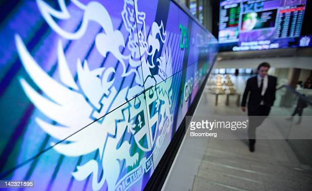 Visitors pass through the main entrance of the London Stock Exchange Group Plc's headquarters as the company holds its first ever charity trading day...
