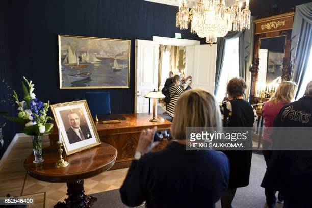 Visitors pass through the presidential castle in Helsinki on May 13 2017 to pay respects to former Finnish President Mauno Koivisto who passed away...