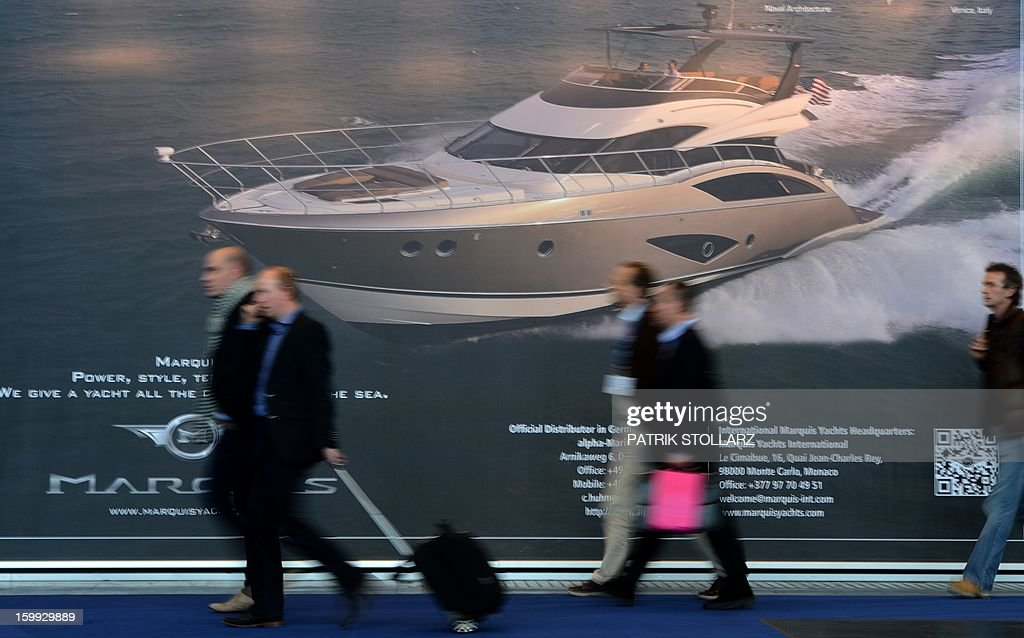 Visitors passes a display which shows motorboats at the Duesseldorf fairground during the Boot fair International Boat Show on January 23, 2013. The event, running from January 19 to January 27, features all boats, yachts, superyachts, electronics, engines and thousands of accessories from every major marine manufacturer and builder worldwide.