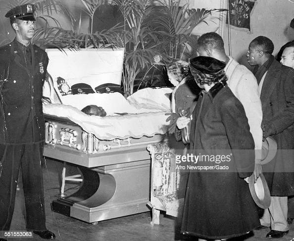 Visitors passing the open coffin of Bill Robinson Bojangles entertainer actor and dancer at his funeral New York City New York March 12 1949