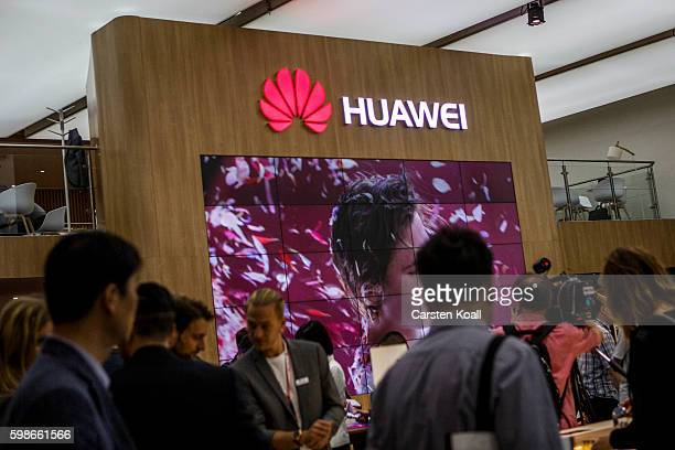 Visitors passing the stand of Huawei at the 2016 IFA consumer electronics trade fair on September 2 2016 in Berlin Germany IFA is among the world's...