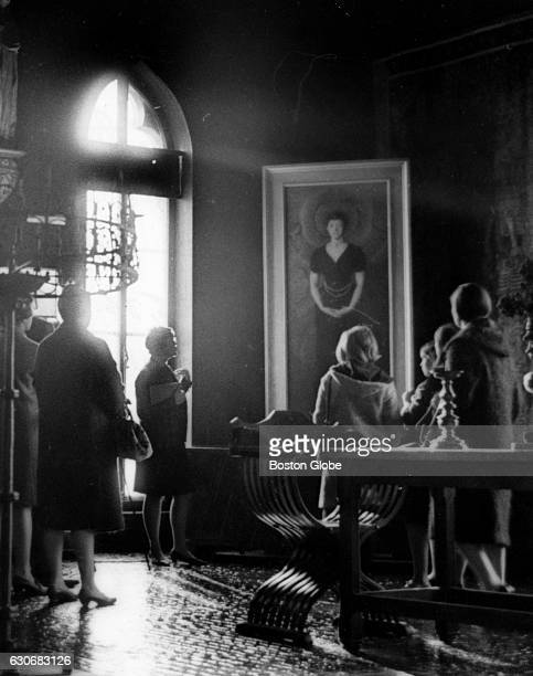 Visitors pause before John Singer Sargent's portrait of Mrs Gardner in the Gothic Room at the Isabella Stewart Gardner Museum in Boston on Nov 15 1966