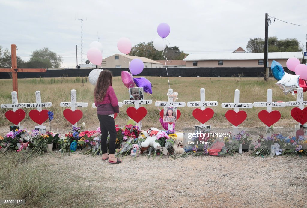 Visitors pay respects at a memorial where 26 crosses were placed to honor the 26 victims killed at the First Baptist Church of Sutherland Springs on November 10, 2017 in Sutherland Springs, Texas. On November 5, a gunman, Devin Patrick Kelley, shot and killed the 26 people and wounded 20 others when he opened fire during Sunday service at the church.