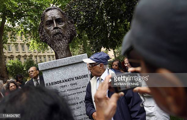 Visitors photograph a sculpture of Indian poet and philopspher Rabindranath Tagore after Britain's Prince Charles unveiled the bust in London on July...
