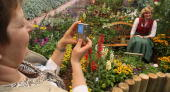 Visitors photograph each other at a garden flower and cultivated plants display of the Julius Kuehn Institute for agricultural research in Berlin at...