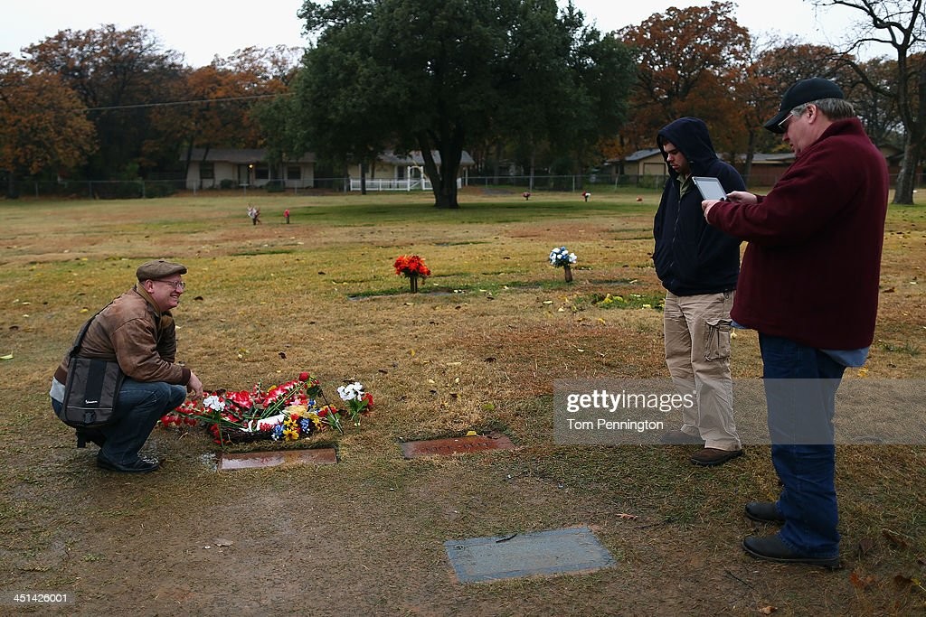 Visitors photograph the grave site of Lee Harvey Oswald at Shannon Rose Hill Funeral Chapel and Cemetery on November 22, 2013 in Fort Worth, Texas. Visitors streamed through the grave site on the 50th anniversary of the assassination of U.S. President John F. Kennedy as he rode in a Presidential motorcade in Dealey Plaza.