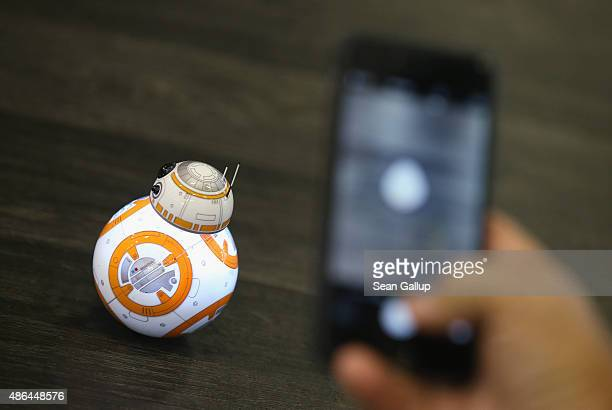 Visitors photograph the Sphero BB8 Star Wars droid at the Sphero stand at the 2015 IFA consumer electronics and appliances trade fair on September 4...