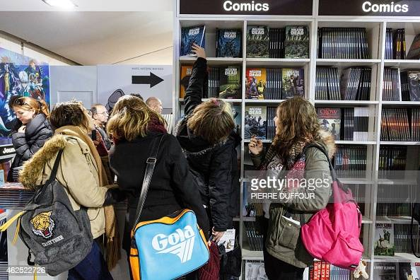 visitors pick up comic books during the 42nd angouleme. Black Bedroom Furniture Sets. Home Design Ideas