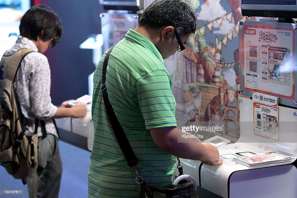 Visitors play Namco Bandai Games Inc.'s video game on Nintendo Co.'s DS handheld game consoles during the Tokyo Game Show 2010 at Makuhari Messe on September 16, 2010 in Chiba, Japan. The computer and video game convention, which will be held until September 19, features exhibitions of upcoming game software and hardware from 194 companies and organizations to draw business visitors and the general public.