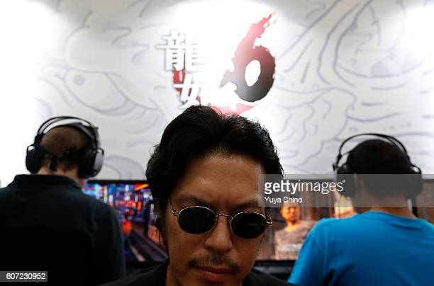 Visitors play Ryu Ga Gotoku 6 or socalled 'Yakuza' video game on Sony Interactive Entertainment Inc's PlayStation 4 game consoles as a staff member...
