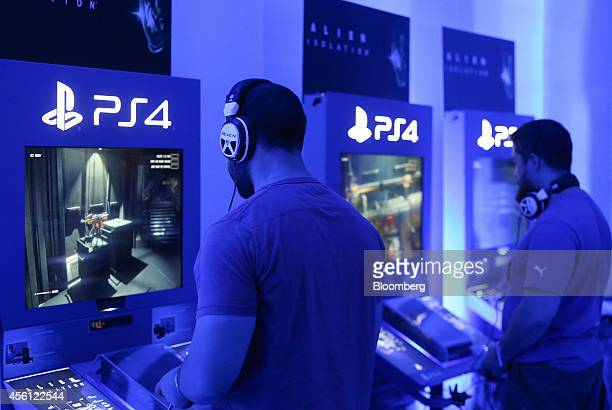 Visitors play the 'Alien Isolation' video game produced by Sega Sammy Holdings Inc on Sony Corp Playstation 4 games consoles during the EGX gaming...