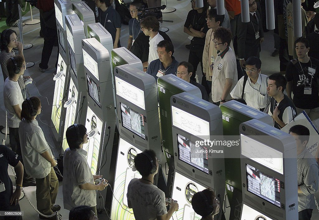 Visitors play Xbox 360 of Microsoft during the Tokyo Game Show 2005 on September 16, 2005 in Chiba, Japan. The show which takes place from September 16 for 3 days is expected to attract 150,000 visitors.