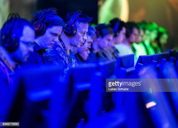 Visitors playing on a computer while visiting the Gamescom 2017 video gaming trade fair on August 22 2017 in Cologne Germany Gamescom is the world's...